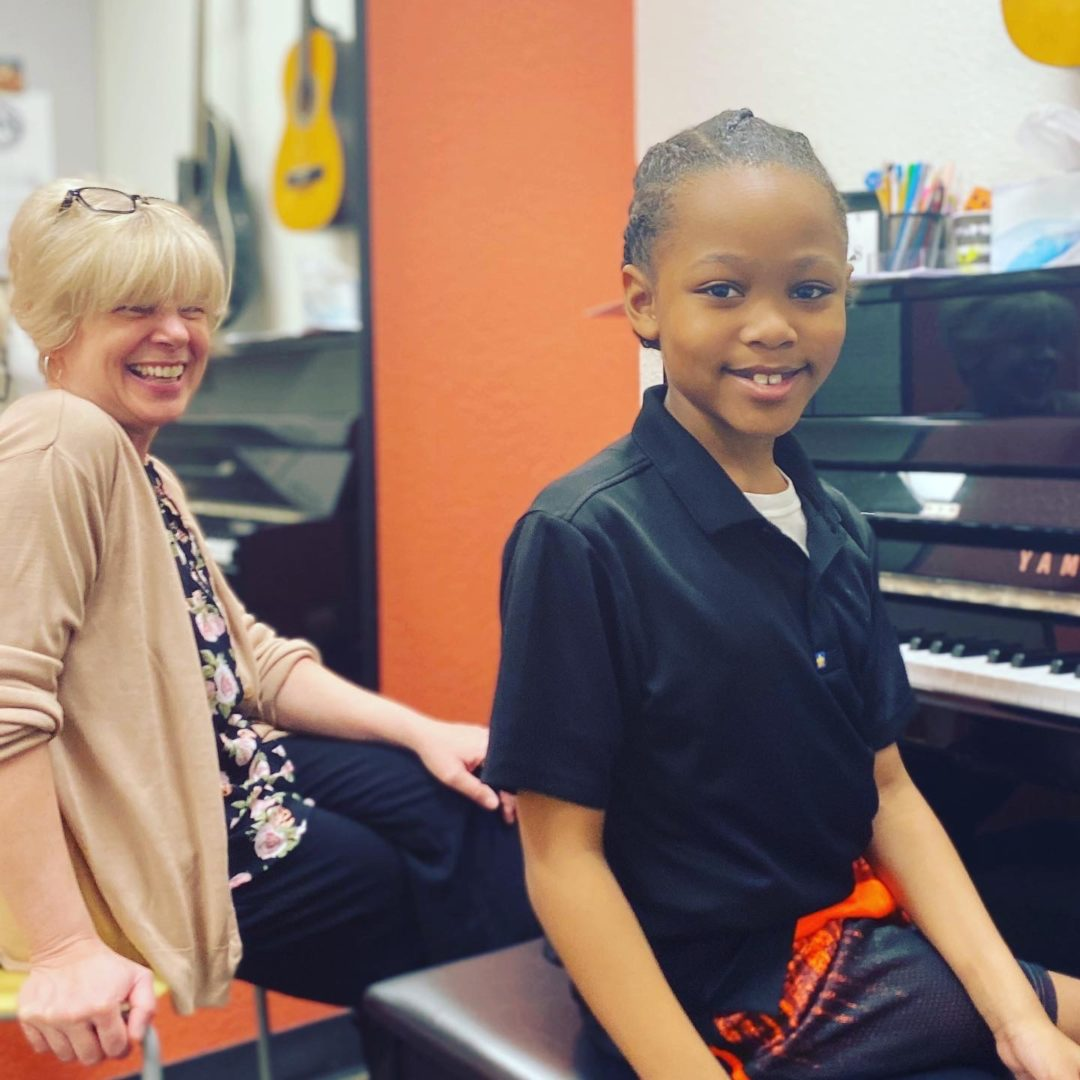 Cheston with his teacher Ms. Cindy at Music Maker Workshops